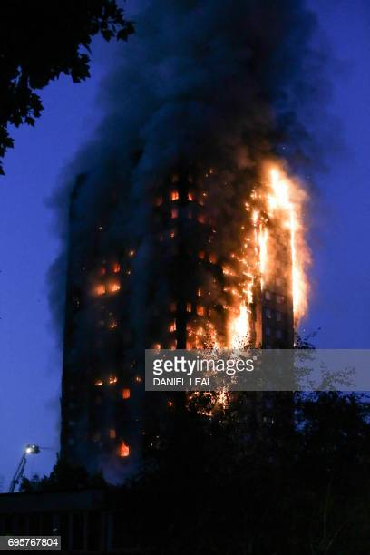 A huge fire engulfs the Grenfell Tower early June 14 2017 in west London The massive fire ripped through the 27storey apartment block in west London...
