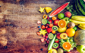 Huge Group of Fresh Fruits on Wooden Background