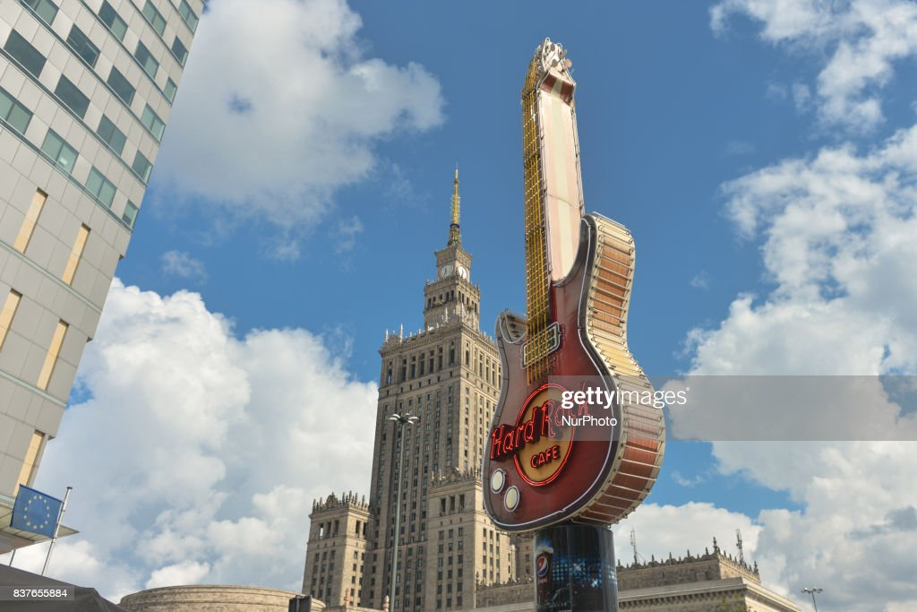 A huge Guitar at Warsaw's Hard Rock Cafe and the Palace of Culture and Science in the background. On Tuesday, August 21, 2017, in Warsaw, Poland.