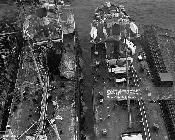Huge hole in deck of Standard Oil tanker J A Mowinckel at Bayonne N J dock indicates force of ship explosion yesterday morning Possibility that a...