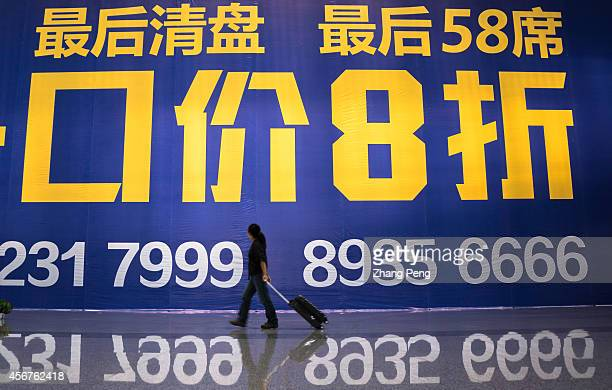 XI'AN SHAANXI CHINA A huge house price discount advertising billboard in Xi'an railway station According to the housing index issued in Sept the...