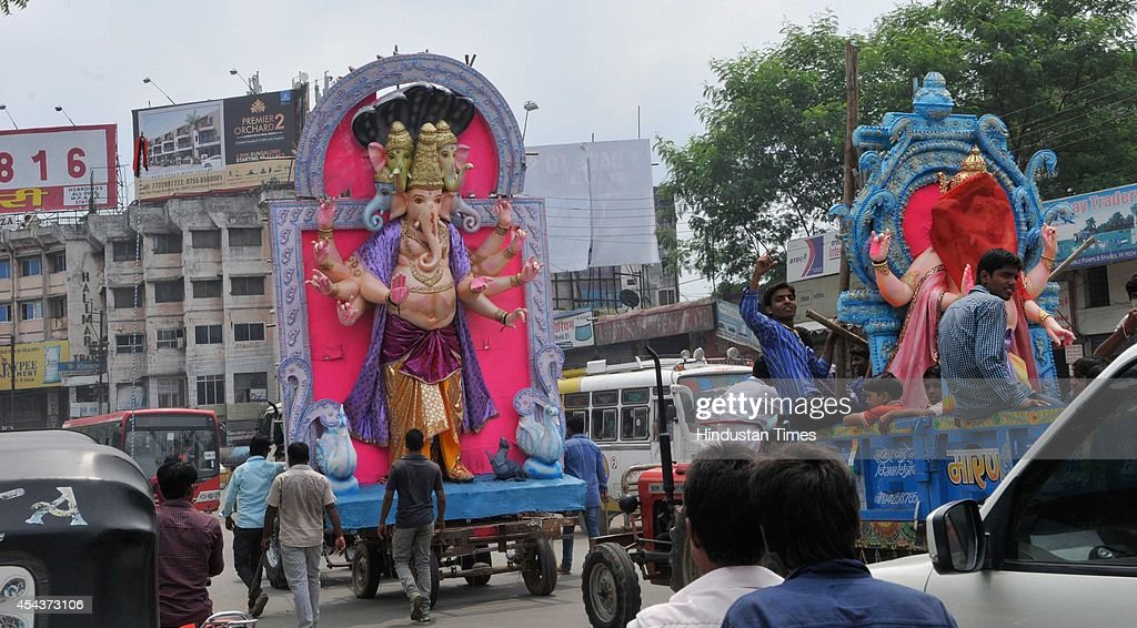 Huge Idols of Lord Ganesha being taken by devouts for its installation at Hamidia road on the occasion of Ganesha Chathurthi festival on August 29, 2014 in Bhopal, India. The ten-day long Ganesh festival kicked off with zeal and fervour across Maharashtra with lakhs of devotees queueing up outside temples to offer prayers to the elephant-headed deity. The district administration has put a ban of use of idols made from plaster of Paris with a view to prevent pollution of rivers and ponds.