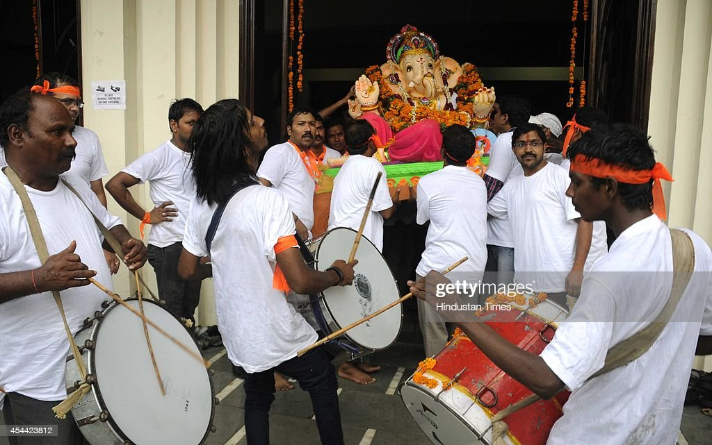 Huge Idols of Lord Ganesha being taken by devouts on the occasion of Ganesha Chathurthi festival on August 31, 2014 in Gurgaon, India. Ganesh Chaturthi festival that is celebrated in honour of lord Ganesha, It will end with the immersion of Ganesh idol in water bodies. The ten-day long Ganesh festival kicked off with zeal and fervour across Maharashtra with lakhs of devotees queueing up outside temples to offer prayers to the elephant-headed deity. The district administration has put a ban of use of idols made from plaster of Paris with a view to prevent pollution of rivers and ponds.