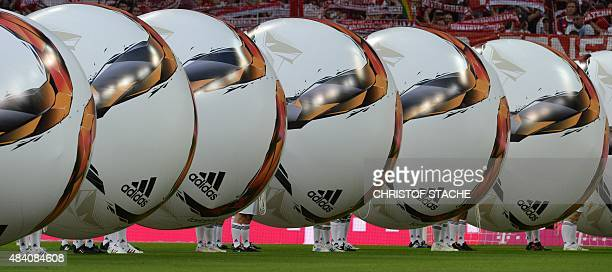 Huge inflatable soccer balls are presented during the opening ceremony of the new German Bundesliga season prior to the German first division...