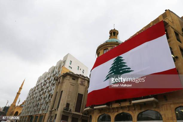 A huge Lebanon's flag is seen hanging over a building in downtown Beirut Lebanon on Tuesday November 21 2017 Lebanon's prime minister Saad Hariri is...