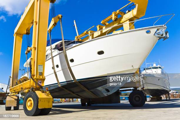 A huge luxury boat on a yellow winch