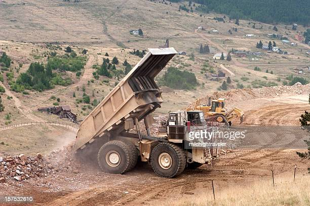 Huge mining ore truck dumps rock in Victor, Colorado