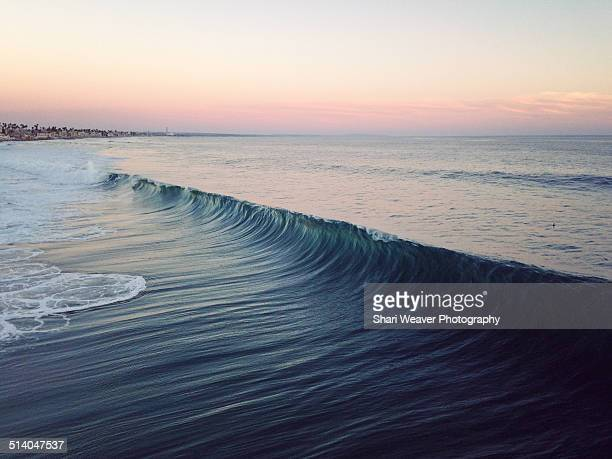Huge ocean swell at sunset