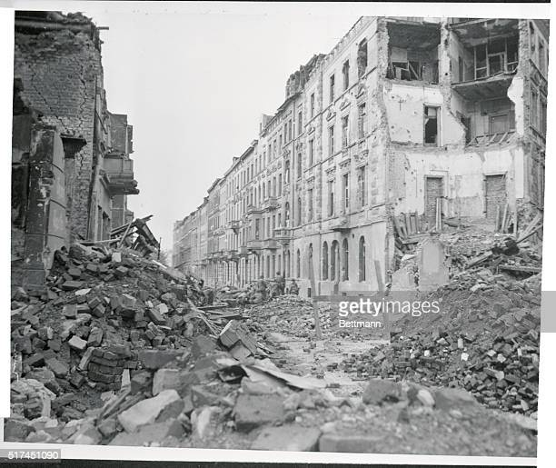 Huge piles of Rubble fill this street in battlesmashed Aachen Germany Many historic buildings were leveled in the heavy shelling and aerial...