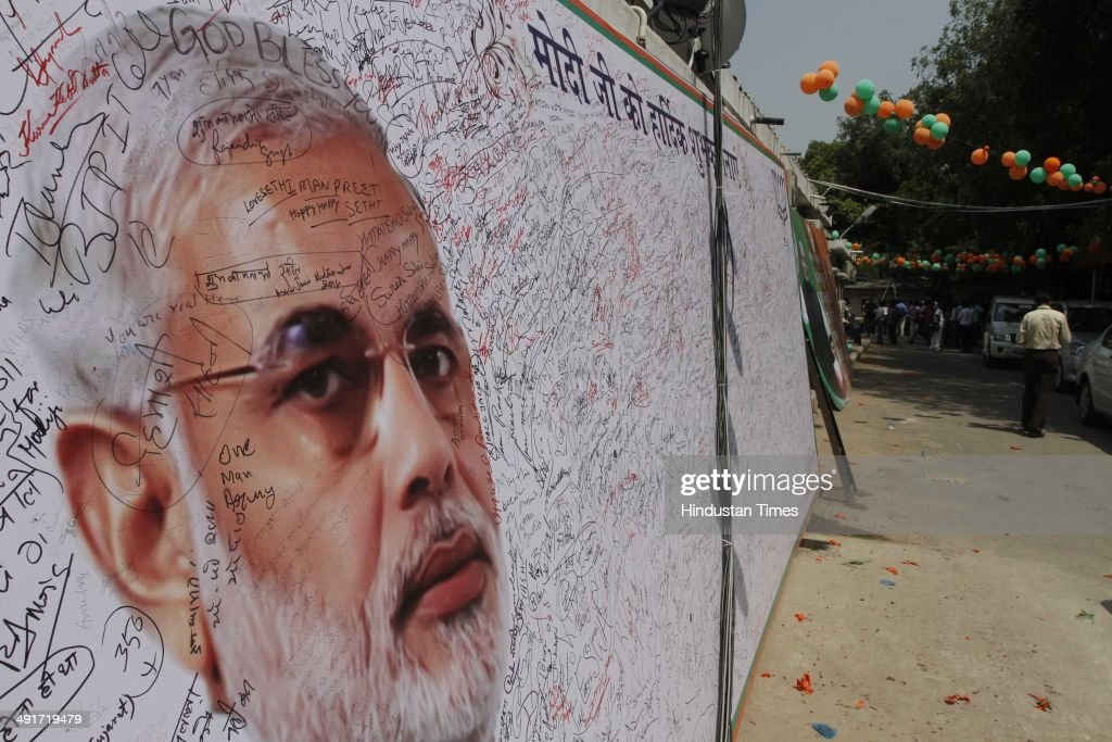 A huge placard erected inside BJP Headquarter, meant to wish BJP prime minister candidate Narendra Modi during the BJP parliament board meeting, after party's landslide victory in Lok Sabha election, at BJP Headquarter office on May 17, 2014 in New Delhi, India. Narendra Modi arrived in the national capital to a rousing welcome by thousands of enthusiastic BJP workers and supporters to whom he gave credit for the historic achievement. He was received at the airport by a number of senior BJP leaders, including party chief Rajnath Singh. As he reached the party headquarters, Modi was showered with rose petals amid chants of his name by supporters. He said, This victory is dedicated to the sacrifices of generations of loyal party workers who have been working tirelessly since 1952. It's the fruit of their blessings, prayers and hard work.