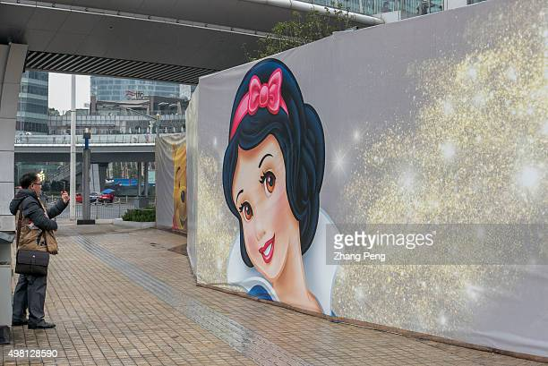 A huge poster of Snow White on the outdoor plaza Disney flagship store located in Lujiazui area of Pudong is the largest retail space of any Disney...