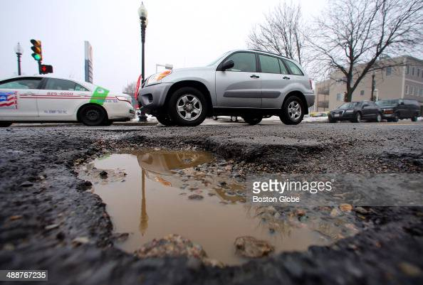 A huge pothole approximately 6 inches deep by two feet by 18 inches opened up in the middle of East Broadway Street at D Street in South Boston