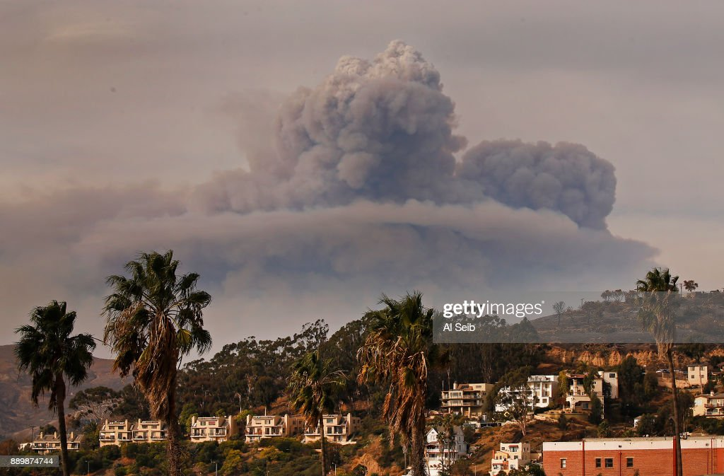 Huge Pyrocumulus cloud of smoke rises to the north of downtown Ventura as seen Sunday afternoon from the Ventura Pier as the Thomas Fire threatens Carpenteria and Montecito.