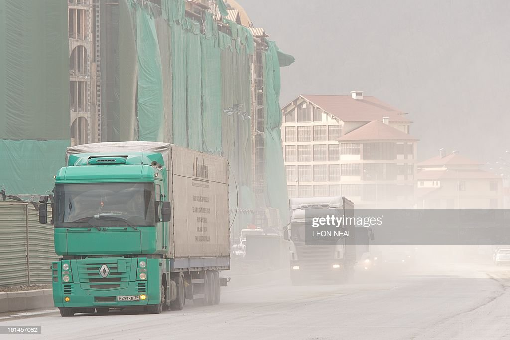 Huge quantities of dust is thrown into the air on a busy stretch of road amid signs of the ongoing construction work in Krasnaya Polyana, near Sochi on February 11, 2013. With a year to go until the Sochi 2014 Winter Games, tests events and World Championship competitions are underway. AFP PHOTO / LEON NEAL