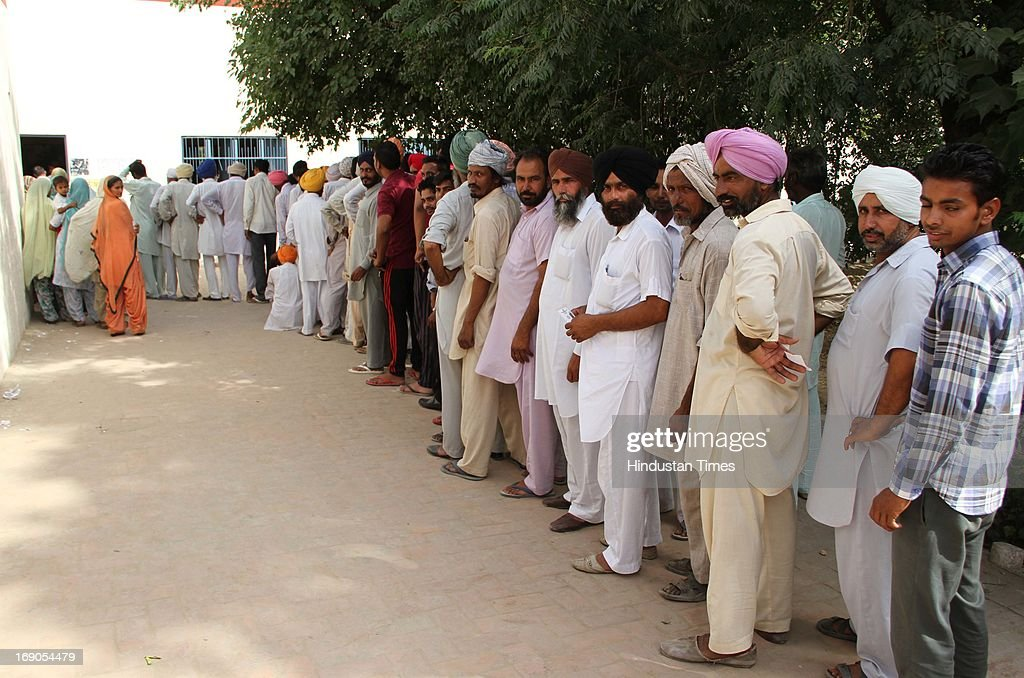 Huge queue of voter at village Gobindpura in District Bathinda for Block Samiti and Zila Prishad election on May 19, 2013 in Bathinda, India. Elections were held today for district level. Several people and policemen were injured after clashes broke out between the workers of the ruling Akali Dal and the opposition Congress following alleged booth capturing by the Akali workers.