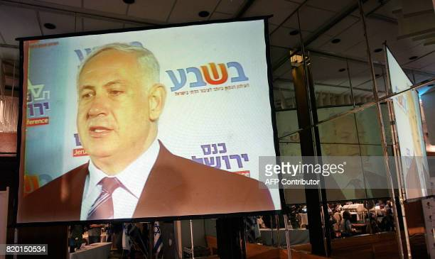A huge screen showing former prime minister Benjamin Netanyahu and leader of the rightwing Likud party is seen as he gives a campaign speech to...