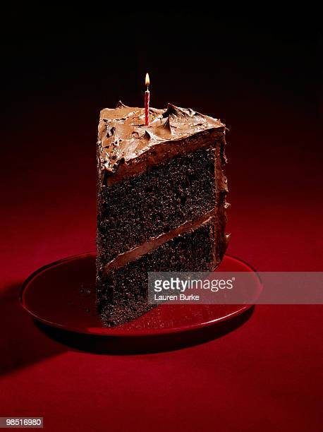 Huge slice of Chocolate Birthday Cake on Red