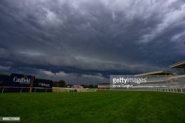 Huge storm is seen over the course delaying the start to Race 7 during Melbourne Racing at Caulfield Racecourse on April 8 2017 in Melbourne Australia