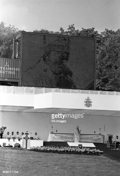 A huge television screen relays Pope John Paul II to the crowds at Bellahouston Park Glasgow as he celebrated Mass before an estimated one third of...