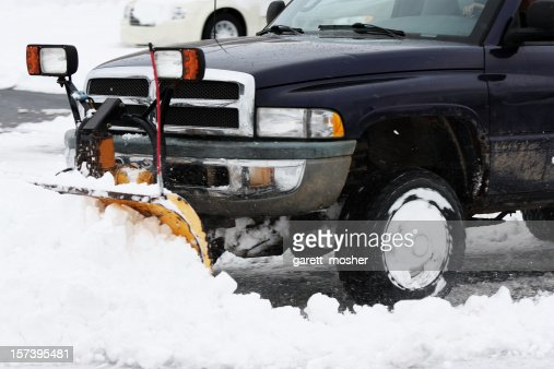 huge truck with plow removing snow