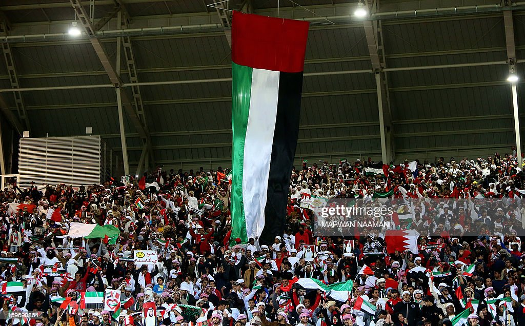 A huge UAE flag hangs over Emarati fans prior the start of the final game between United Arab Emirates and Iraq for the 21st Gulf Cup in Manama, on January 18, 2013.