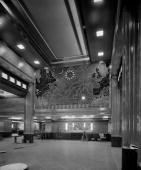 A huge wall map designed by Macdonald Gill adorns the First Class dining room of the transatlantic passenger liner SS Queen Mary and a series of...