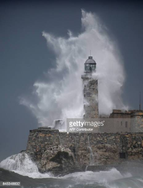 A huge wave breaks against Morro Castle in Havana on September 10 2017 Deadly Hurricane Irma battered central Cuba on Saturday knocking down power...