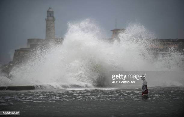 TOPSHOT A huge wave breaks near the Morro Castle in Havana on September 10 2017 Deadly Hurricane Irma battered central Cuba on Saturday knocking down...