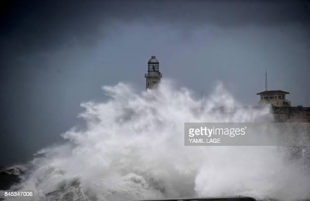 A huge wave breaks near the Morro Castle in Havana on September 10 2017 Deadly Hurricane Irma battered central Cuba on Saturday knocking down power...