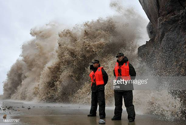 A huge wave hits the dike as Typhoon Fitow moves to make its landfall in Wenling east China's Zhejiang province on October 6 2013 China was on its...