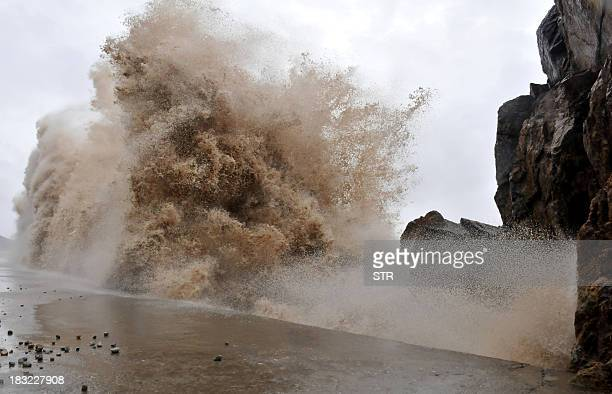 Huge wave hits the dike as Typhoon Fitow moves to make its landfall in Wenling east China's Zhejiang province on October 6 2013 China was on its...