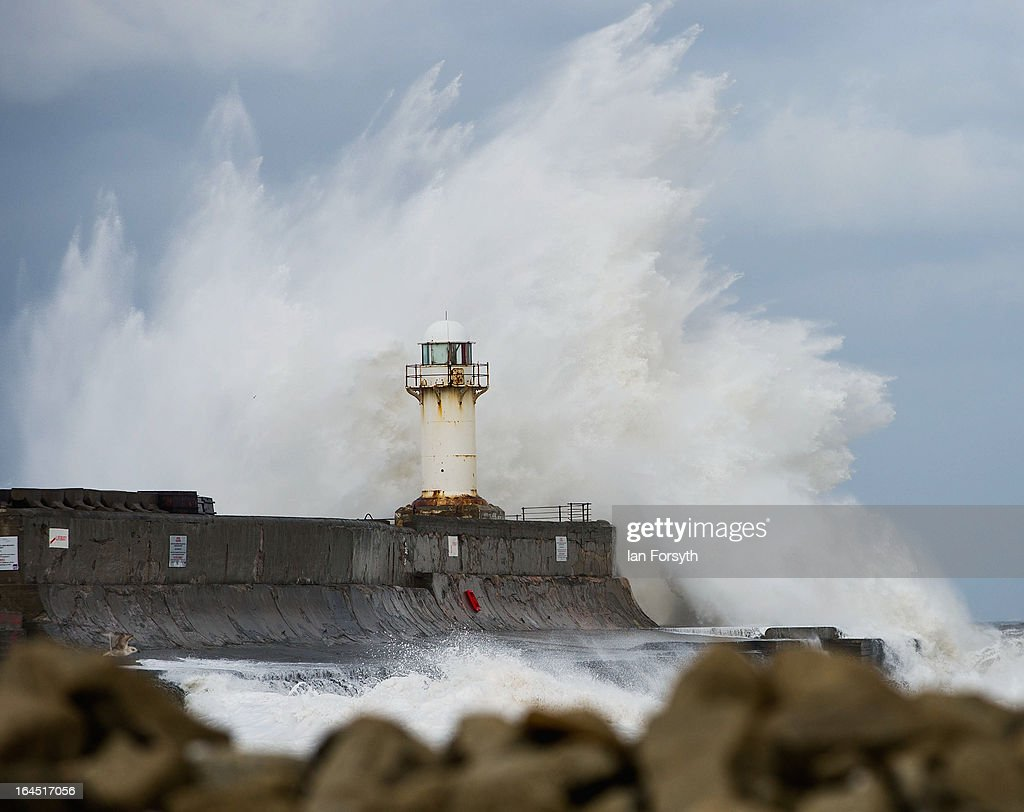 Huge waves crash against the South Gare lighthouse on March 24, 2013 in South Gare, Teesside, England. Strong winds continue to batter the East coast as unseasonal weather hits many part of the United Kingdom.