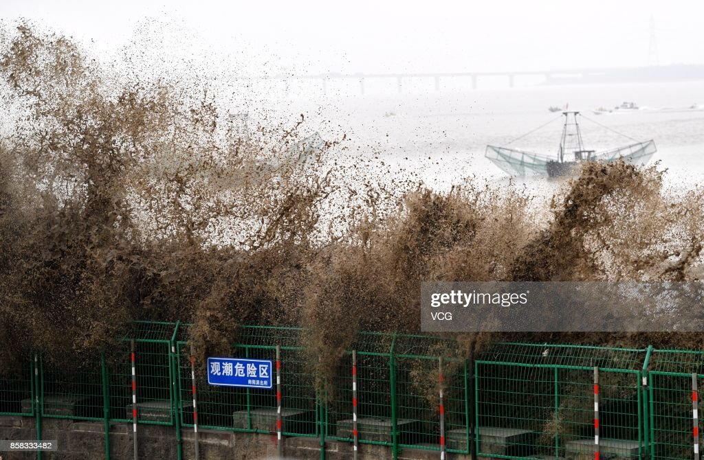 Huge waves of the Qiantang River roll onto the seashore on October 6, 2017 in Hangzhou, Zhejiang Province of China. When the surging tide comes, around 110,000 visitors flock there to watch it.