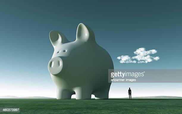 Huge white piggy bank on green gras