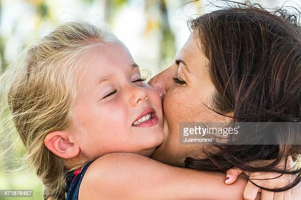 Hugging her mon