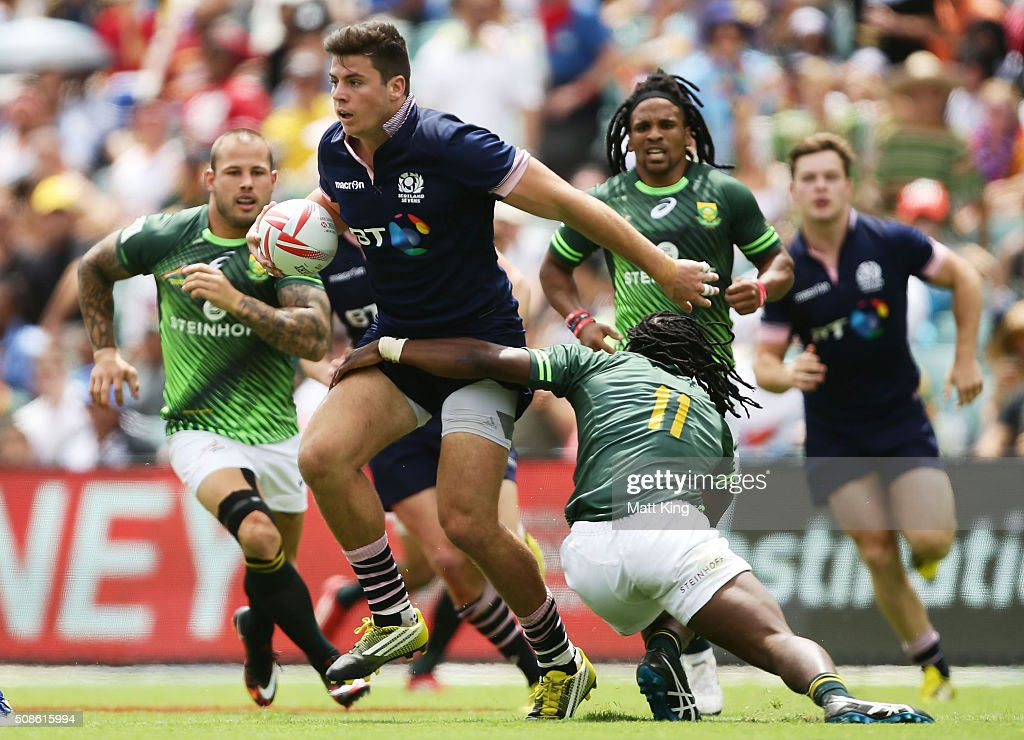 <a gi-track='captionPersonalityLinkClicked' href=/galleries/search?phrase=Hugh+Blake&family=editorial&specificpeople=9480797 ng-click='$event.stopPropagation()'>Hugh Blake</a> of Scotland takes on the defence during the 20146 Sydney Sevens match between South Africa and Scotland at Allianz Stadium on February 6, 2016 in Sydney, Australia.