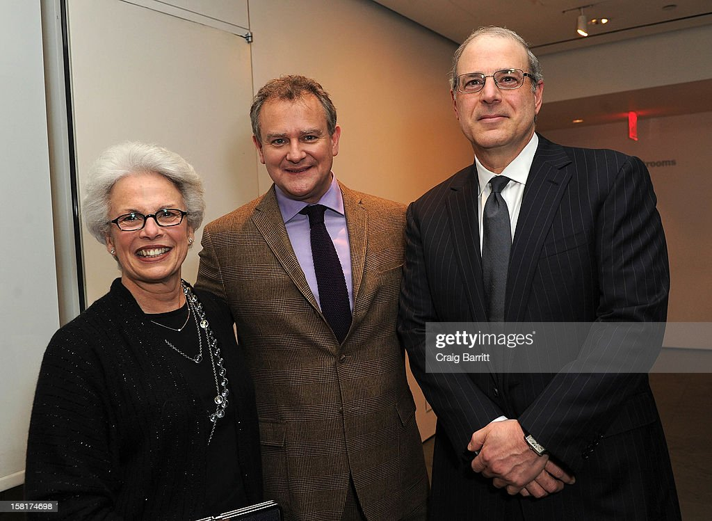Hugh Bonneville (c) and guests attend an evening with the cast and producers of PBS Masterpiece series 'Downton Abbey' hosted by Ralph Lauren & Graydon Carter on December 10, 2012 in New York City.