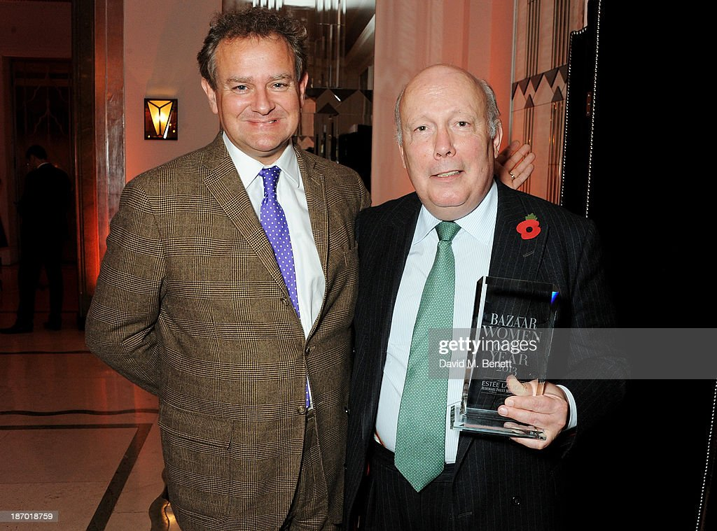 Hugh Bonneville (L) and Julian Fellowes, accepting the Special Contribution award for 'Downton Abbey', attend the Harper's Bazaar Women of the Year awards at Claridge's Hotel on November 5, 2013 in London, England.