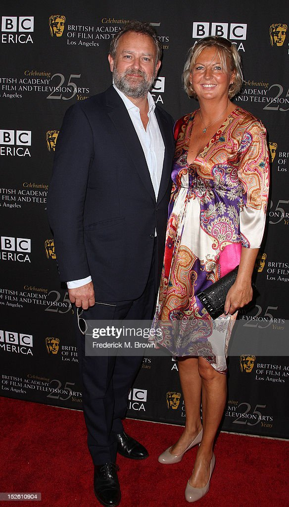 <a gi-track='captionPersonalityLinkClicked' href=/galleries/search?phrase=Hugh+Bonneville&family=editorial&specificpeople=228840 ng-click='$event.stopPropagation()'>Hugh Bonneville</a> (L) and Lulu Williams attend BAFTA LA TV Tea 2012 Presented By BBC America at The London Hotel Hollywood on September 22, 2012 in West Hollywood, California.