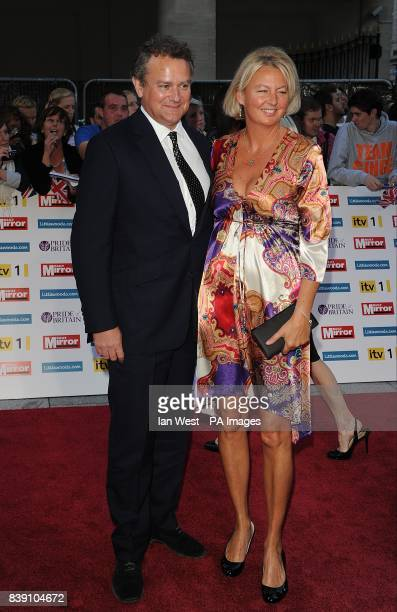 Hugh Bonneville and wife Lulu arriving for the Pride of Britain awards at the Grosvenor House Hotel London