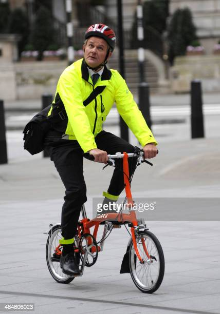 Hugh Bonneville pictured being filmed whilst cycling outside the BBC on January 24 2014 in London England