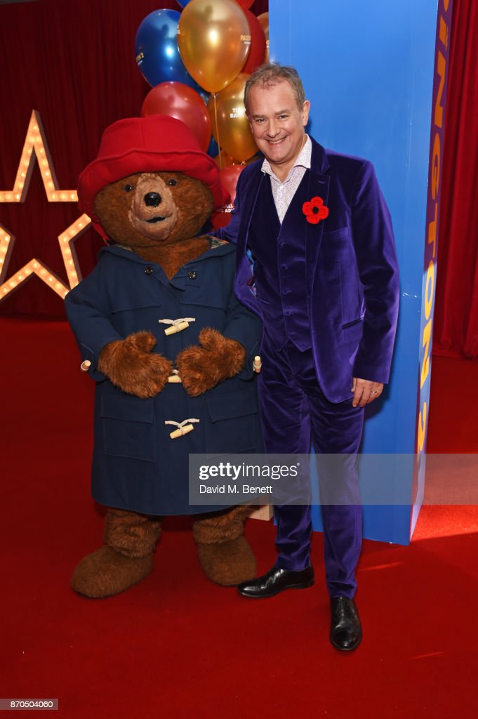 Hugh Bonneville (R) poses with Paddington Bear at the World Premiere of 'Paddington 2' at Odeon Leicester Square on November 5, 2017 in London, England.