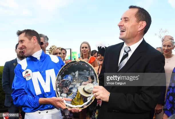 Hugh Bowman and trainer Chris Waller pose with the plate after Winx won Race 9 Ladbrokes Cox Plate during Cox Plate Day at Moonee Valley Racecourse...