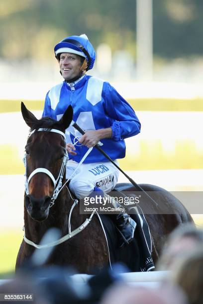 Hugh Bowman celebrates after riding Winx to win the Warwick Stakes during Sydney Racing at Royal Randwick Racecourse on August 19 2017 in Sydney...