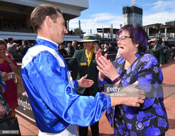 Hugh Bowman is about to hug an emotional part owner Debbie Kepitis after Winx won Race 5 Turnbull Stakes during Turnbull Stakes day at Flemington...