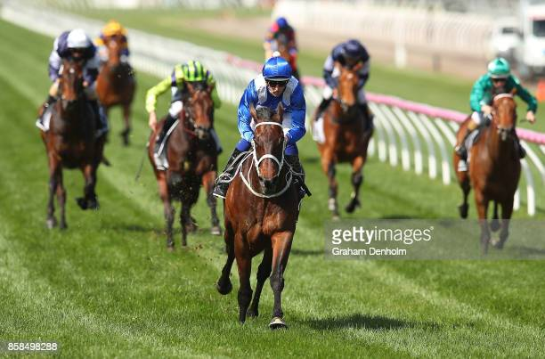Hugh Bowman rides Winx to win the Seppelt Turnbull Stakes during Turnbull Stakes Day at Flemington Racecourse on October 7 2017 in Melbourne Australia