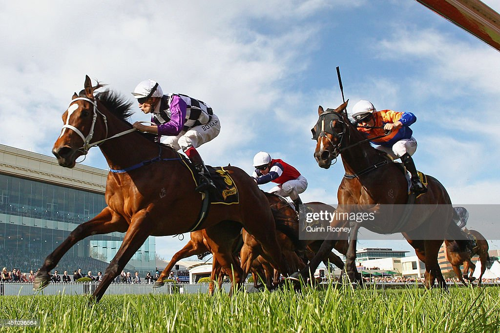 Hugh Bowman riding Amicus leads the field across the line to win the Schweppes Thousand Guineas during Caulfield Guineas Day at Caulfield Racecourse...