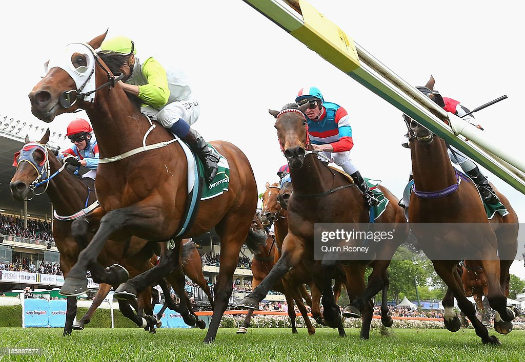 Hugh Bowman riding Hvasstan crosses the line to win the Drummond Golf Handicap during Cox Plate Day at Moonee Valley Racecourse on October 26, 2013 in Melbourne, Australia.