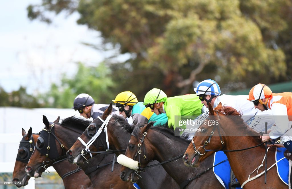 Hugh Bowman riding Lycurgus, Luke Nolen riding Hardham and Regan Bayliss riding So Belafonte and Craig Newitt riding Pablo's Express at barrier start of Race 3 during Melbourne Racing at Caulfield Racecourse on October 1, 2017 in Melbourne, Australia.