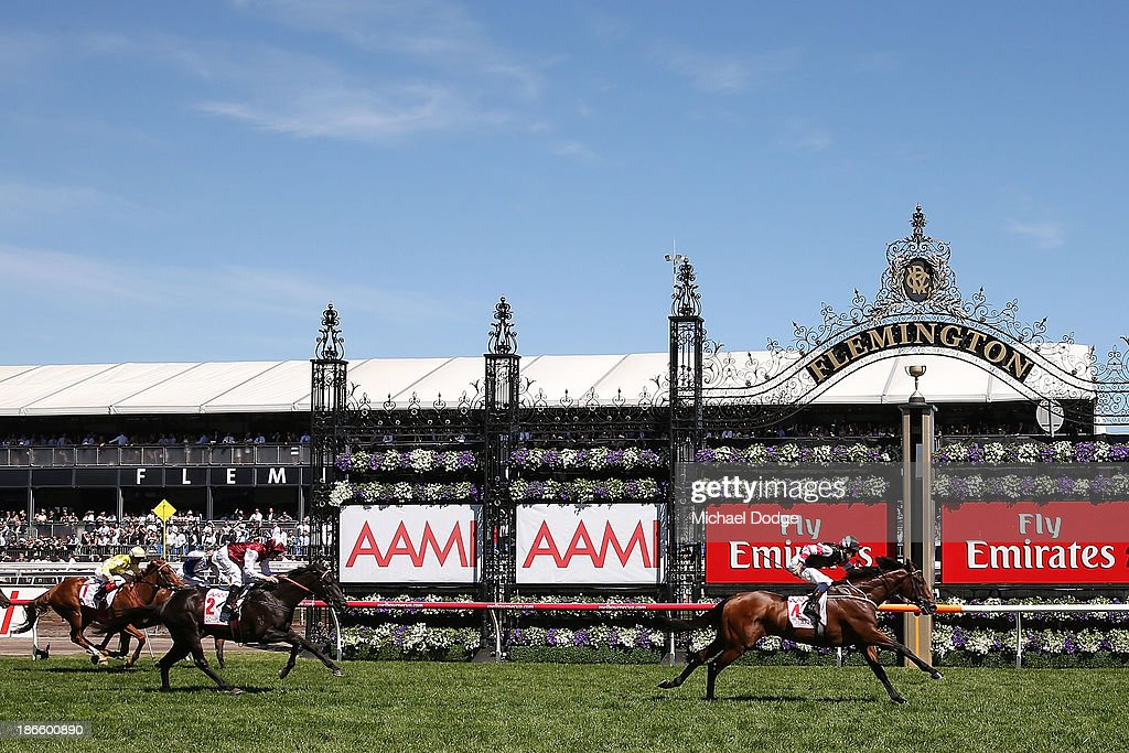 Hugh Bowman riding Polanksi defeats Kerrin McEvoy on Complacent to win race 6 the AAMI Victoria Derby during Derby Day at Flemington Racecourse on November 2, 2013 in Melbourne, Australia.